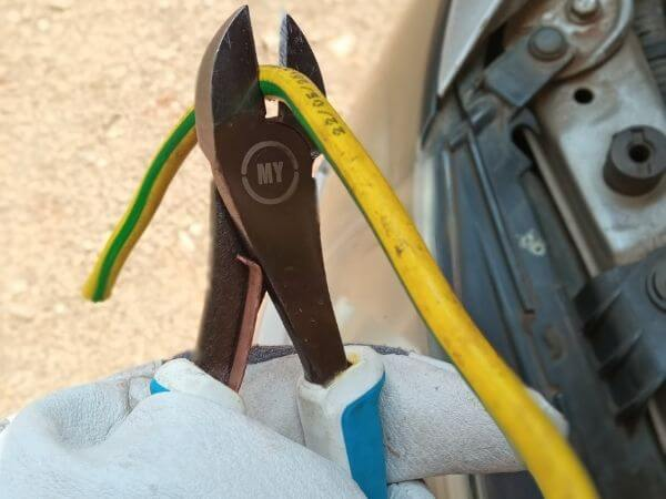 Pliersman cutting electrical cable with diagonal  cutters